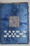 Wove across hole in cotton from indigo dyeing + metallics. Paper weaving below. Has possibilities