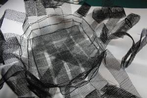 sample -aluminium mesh with twining in progress